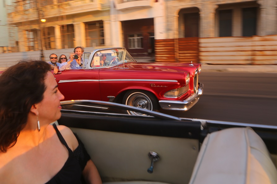 U.S. visitors to Cuba riding in a 1958 Edsel Corsair on the Malecon, Havana, Cuba, at sunset; copyright Christopher P Baker